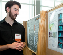 Junior geosciences major Mitch Mitchell discusses his poster. Photo by Denise Applewhite, Office of Communications.