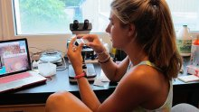 McKenna became interested in coral during the summer of 2012 while working as an education intern at BIOS. Above, she prepares slides to present to a group of teenagers at Waterstart, the marine science camp at BIOS. (Photo courtesy of Elizabeth McKenna)