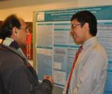 Princeton undergraduate presenting his research at a poster session