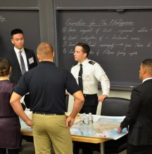 At the beginning of the exercise, attendees formulate their strategy for the day. (Photo credit: Katherine Elgin)