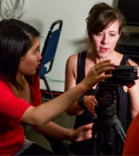 "Purcell Carson (right), the instructor of the class ""Documentary Film and the City,"" helps Princeton University student Sharon Deng set up a camera during an interview at the YMCA of Trenton. Students are creating short doumentaries to tell stories of Trenton, New Jersey, its people and the ways they make a living. Photo by Denise Applewhite, Office of Communications"