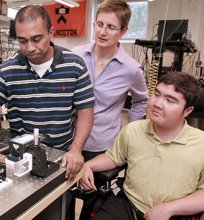 A new system developed by Princeton researchers uses a laser to allow diabetics to check their blood sugar without pricking their skin. Members of the research team included, from left, Sabbir Liakat, a graduate student in electrical engineering; Claire Gmachl, the Eugene Higgins Professor of Electrical Engineering; and Kevin Bors, who graduated in 2013 with a degree in electrical engineering. (Photos by Frank Wojciechowski)