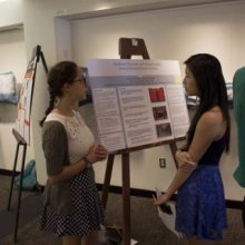 Students discussing at poster presentation